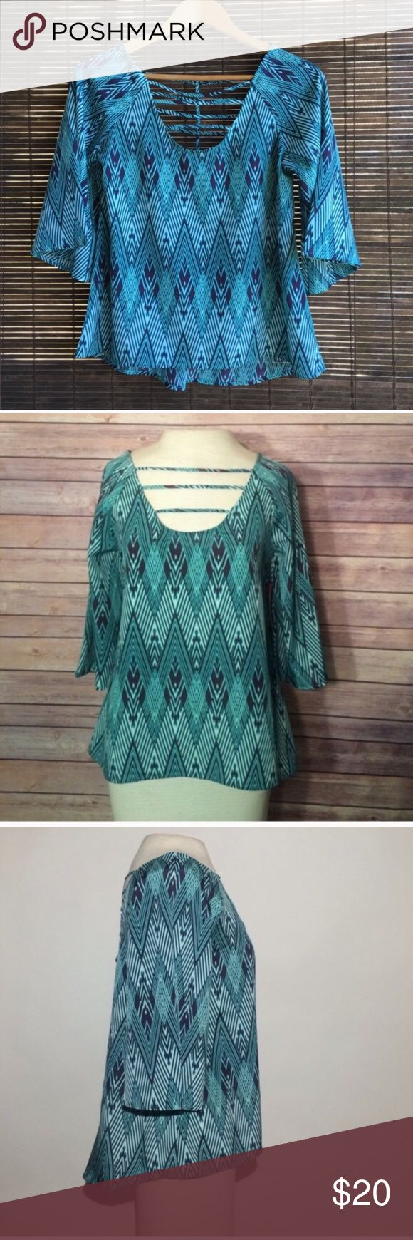 Blue chevron blouse with cut outs and bell sleeves This is a one of a kind sample shirt NWT. Size small. Unique cut outs and bold print NO TRADES! Fast shipping! Have questions on the size? Ask! I'm happy to provide all measurements! Tops Blouses