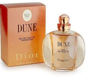 Dune symbolizes escape into the world of dreams where only peace resides; it's a place where sun kisses the sea, rays of light gently caresses the skin and twinkle in the warm sand while the tinkling ocean breeze brings flowery wafts peony and lily. Dune was launched in 1991. This perfume is created by Jean-Louis Sieuzac and its top note includes bergamot, mandarin, palisander, aldehyde, peony and broom followed by heart note composed of jasmine, rose, ylang-ylang, lily, wallflower, lichen…