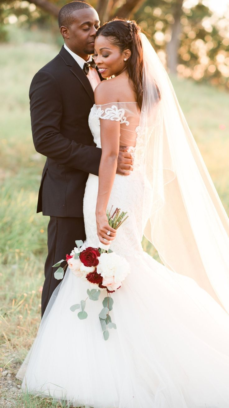 Never pass up a mermaid moment! Fit-and-flare wedding dress Cassandra by Sottero and Midgley / real bride courtesy of Lindsey Mueller Photography / Golden hour portraits / Crimson and white bouquet