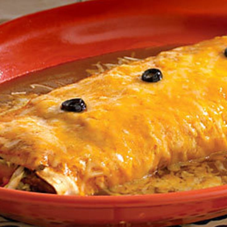 "There is a fantastic Mexican restaurant nearby where I used to live in Indiana called the ""Hacienda"", and they are FAMOUS for their ""wet burritos"". (Which basically means they are SMOTHERED in cheese!!!! LOL!!) They are WONDERFUL!! Here is my very own homemade version of them! (These are big, but that's the way they serve them at the restaurant.) Don't let the lengthy directions fool you!! They are EASY to make!! Hope you try them! :)  *You can also make these with ground beef, shredded ..."