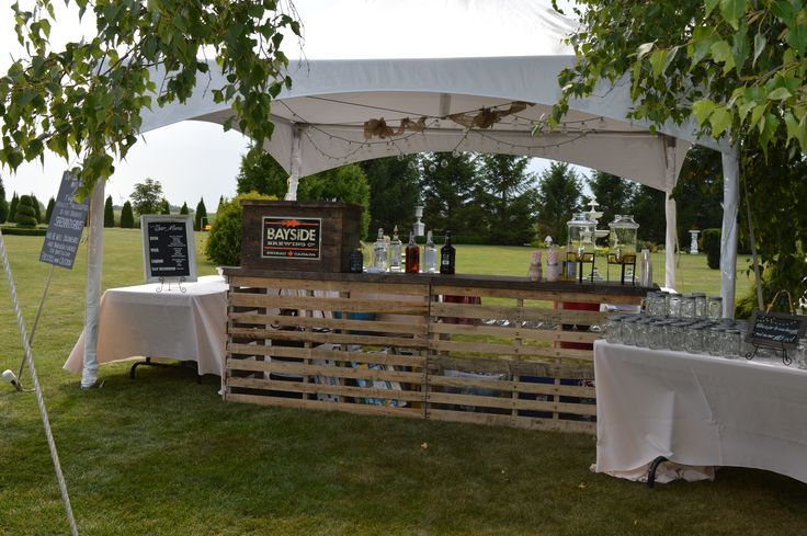 Be creative and plan ahead! This bar counter made by the brides father and future son-in-law, worked well for this wedding.