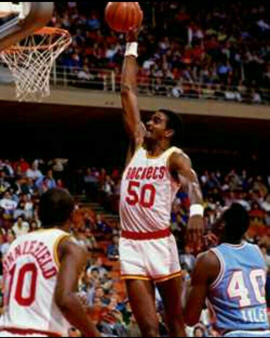 Ralph Lee Sampson, Jr. (born July 7, 1960) is a retired American basketball player. A 7-foot-4 phenom, three-time College Player of the Year, and No. 1 pick in the 1983 NBA Draft, Sampson brought heavy expectations with him to the NBA. The NBA Rookie of the Year, Sampson averaged 20.7 points and 10.9 rebounds for his first three seasons with the Houston Rockets before injuries began to take their toll. Three knee surgeries later he retired a four-time All-Star whose career highlight ended up…