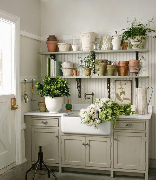 love the shelves with all the fun pots!