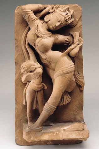 """Celestial Entertainer  India, Rajasthan or Uttar Pradesh; 10th century  An Indian text on temple art notes the auspicious importance of these figures: """"As a house without a wife, as frolic without a woman, so, without the figure of a women the monument will be of inferior quality and will bear no fruit.""""  Asia Society"""
