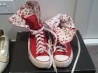 These are super-high sneakers by Converse in a size fitting 39, not sure exactly what that is in Converse sizes. They're a pinkish-red with a red on white floral pattern on the inside! Barely worn! - $15