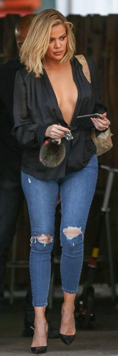 Khloe Kardashian: Shirt – Givenchy  Purse – Chanel  Key Chain – Fendi  Jeans – Topshop  Shoes – Christian Louboutin