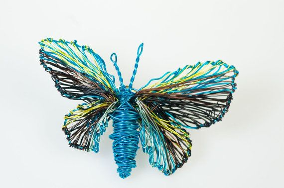#Turquoise #ButterflyBrooch #Wire#butterfly #jewelry #Wiresculpture #Artbrooch #Colorfuljewelry #Mothersgift #Contemporaryjewelry #Unique #etsy #vmikro This is a turquoise butterfly brooch wire butterfly jewelry made of colored copper and silver wire. The height of the wire sculpture art butterfly brooch colorful jewelry is 4cm (1.57in) and the width (body with wings) of the unique mothers gift contemporary jewelry is 6.5cm (2.56in). The pin of the brooch is bronze.