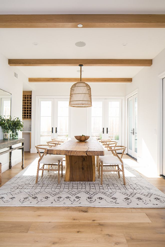 Benjamin Moore White - Isn't this modern farmhouse dining room dreamy? I love the natural light, the French doors and decor. Home Bunch Blog (see sources for rug & decor)