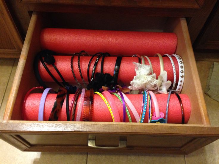 Cut pool noodles to length of drawer to organize head bands.  This is a great idea to keep all those head bands in one place.. I am soo going to do this.