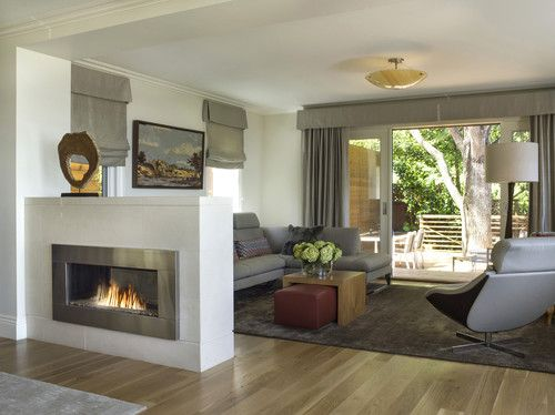 Love the simplicity...of the design and each of the elements...esp. love the double-sided fireplace and its unique placement as a room divider
