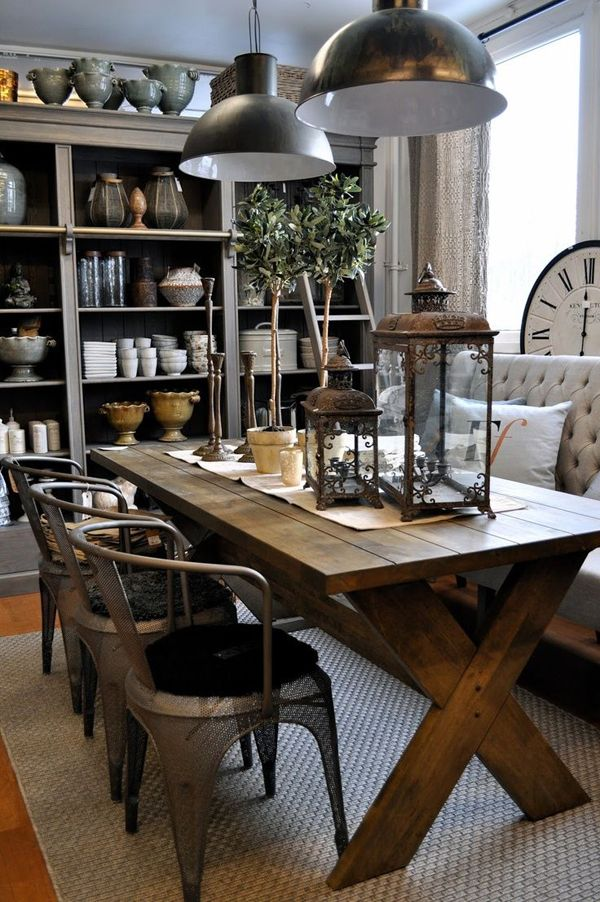 Farmhouse-style table with industrial seating and a shelf full of knick-knacks.