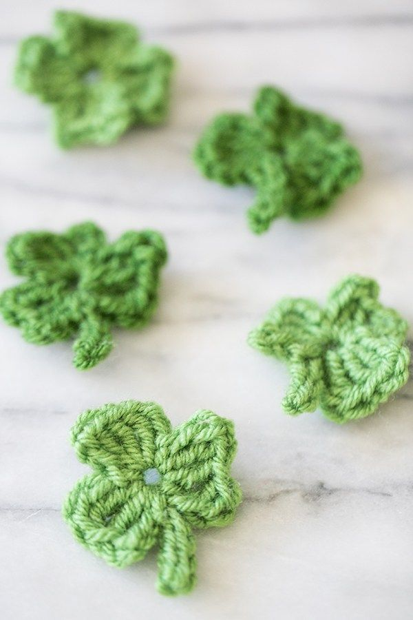 DIY - Crochet these adorable Little Green Shamrocks for St. Patrick's Day!  Makes a very cute pin or decoration.