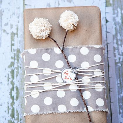 gift wrapped with a pom pom detail
