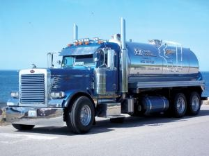 June 2012- Owner Rob Beck had a blue and chrome 2006 Peterbilt 379EXHD with flamed hood built out by Amthor International with a 4,000-gallon aluminum tank tied to an NVE 367 Challenger vacuum pump. The truck is powered by a Cat C15 powerplant wed to an 18-speed Eaton Fuller transmission. The tank features top and rear manways, triple sight glasses on the rear, work lights and 4-inch inlet and 6-inch dump valves. The truck is enhanced by chrome accents, including stacks, visor and toolboxes.