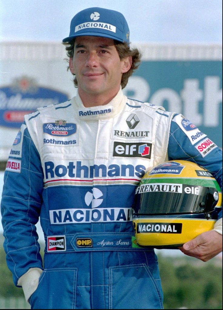 Three-time Formula One world champion Ayrton Senna of Brazil poses for photographers during the presentation of the Williams team for the 1994 season at Estoril circuit on January 19 1994. On Thursday, nearly three years after Senna died in a crash during the San Marino Grand Prix, Frank Wiliams, head of the Williams team, and five other top Formula One figures will face manslaughter charges in a trial that could threaten the future of the sport. (AP Photo/Armando Franca)