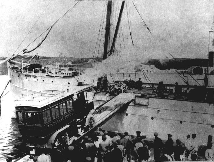 Unloading a steam bus in the harbor of Maó, Menorca