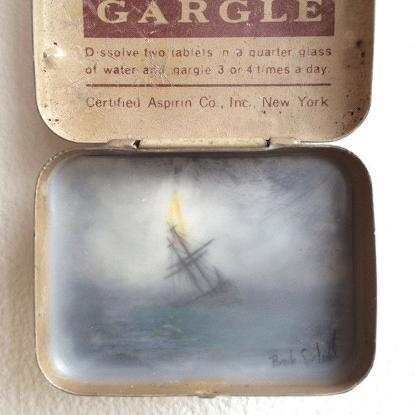"graphite, mylar, wax, vintage tin1.25"" x 1.75"""