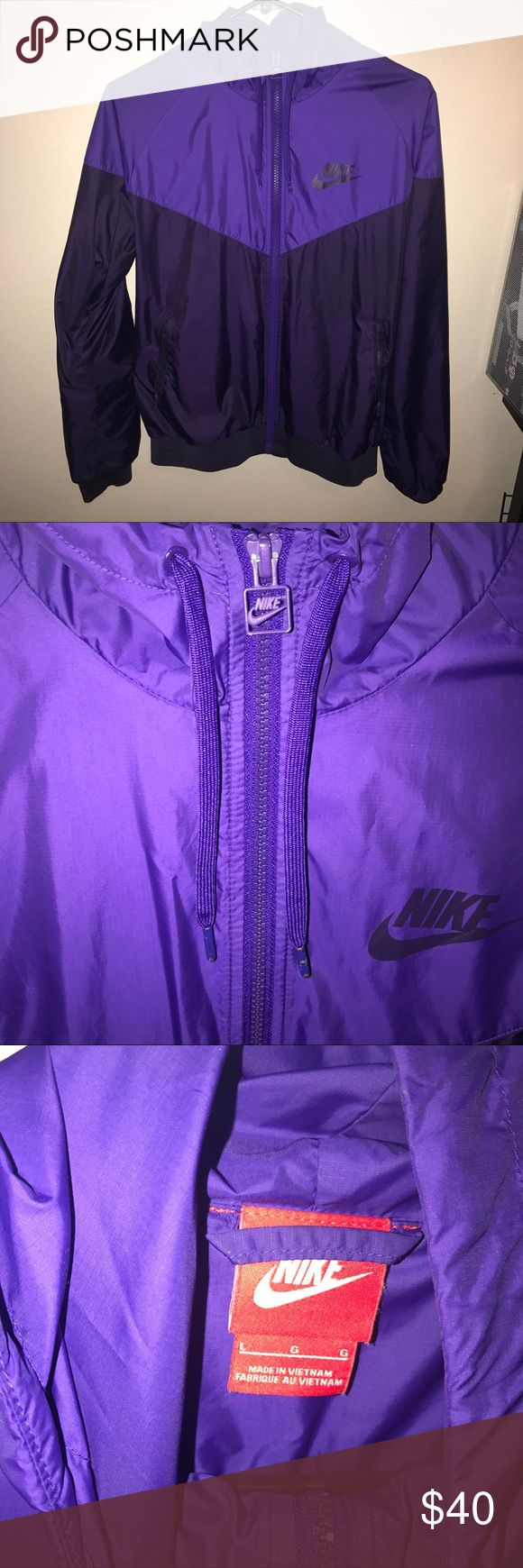 Nike Windrunner Purple windrunner jacket. Size large but I normally wear a medium so fits small. Light wear and tear on ends of drawstring and on zipper tab. Nike Jackets & Coats