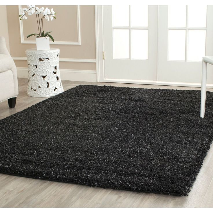 Perfect for a cozy bedroom, this 8 x 10 power-loomed black shag rug is deep enough to double as a crash pad for tired toes. Its dense one-inch pile is water-repellant and antimicrobial