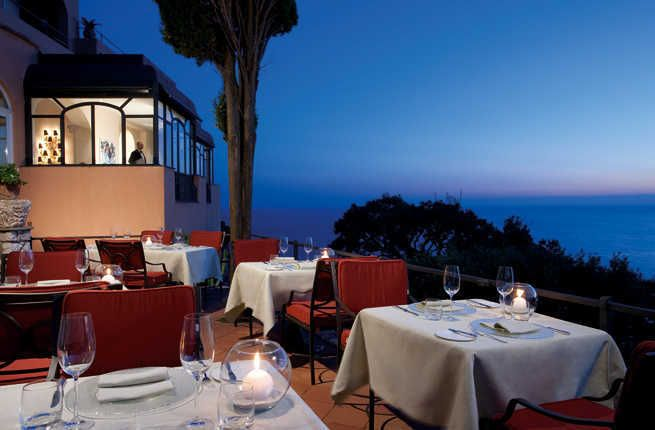 Couples who stay at Punta Tragara will enjoy amazing views of the Faraglioni rocks and the Mediterranean Sea, as well as a garden with two pools. A candle-lit dinner of Neapolitan cuisine and Capri favorites on Monzù Restaurant's panoramic veranda is sure to be one to remember.