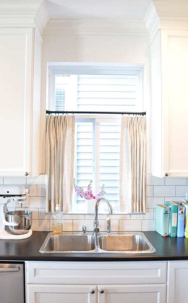Love cafe curtains over a sink! this will prob work best for my kitchen window since I am building a few shelves at the top part in front of window!