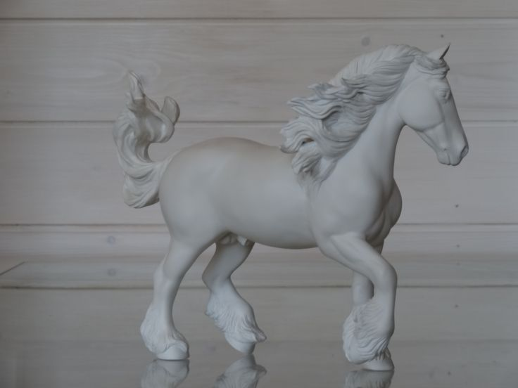 2017. Customized Breyer Traditional size friesian to gypsy vanner stallion. Sold unpainted. Custom by Zane Lahdenranta (Frosty Birch Studio).
