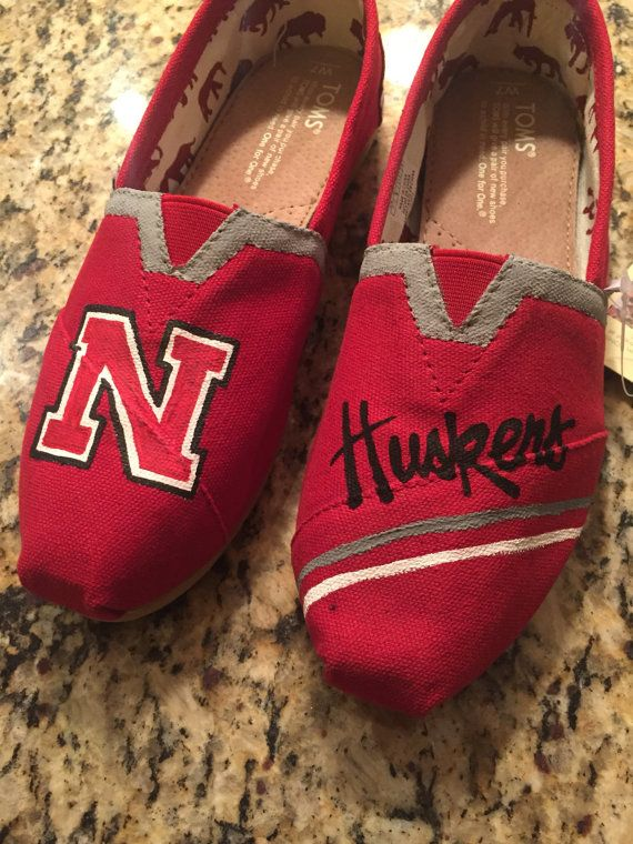 Made to order, hand painted, Nebraska TOMS. Acrylic paint.