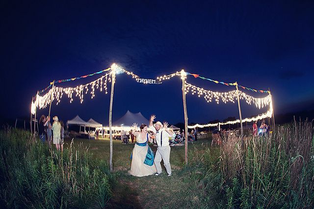 outdoor tent wedding night flags fun twinkly lights