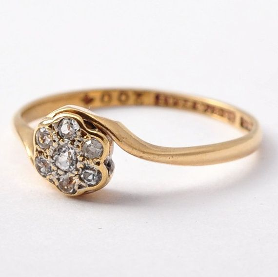 {O F F E R I N G} An c.1920s alternative engagement ring. A center 2mm diamond is surrounded by six 1.5mm diamonds in a daisy flower platinum