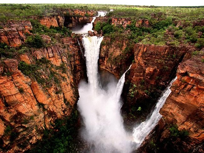 """#Kakadu   Northern Territory #Australia    This World Heritage-listed National Park is also Australia's largest, covering almost two million hectares of wilderness. Located 170 kilometres south-east of Darwin, you'll find """"dramatic escarpments, gob-stopping waterfalls and 40,000 years of Australian indigenous history."""""""