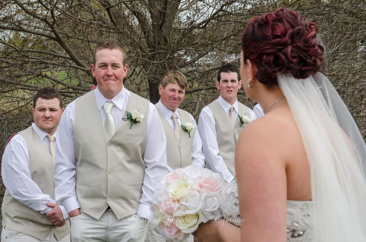 Wedding photographer, Candid Photos of a Lifetime  The grooms 1st look of his gorgeous bride