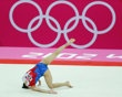 Moldir Azimbay of Kazakhstan falls during her floor exercise during the women's gymnastics qualification at the North Greenwich Arena during the London 2012 Olympic Games July 29, 2012. http://www.PaulFDavis.com/success-speaker (info@PaulFDavis.com)