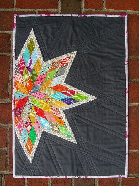 Scrappy Lone Star quilt with link to a tutorial.love the quilting on this