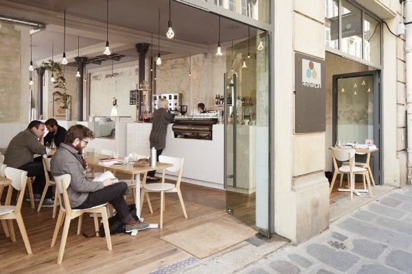 This space does a brilliant job of bringing the outside in. Bright and airy the light wooden tones, bright whites and bi-fold doors make this space inventing and fresh.  #Hege in France Café Coutume Paris photo by David Foessel