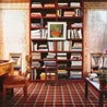"Upstate New York library of legendary hairstylist Kenneth Battelle—whose clientele included Jacqueline Kennedy and Marilyn Monroe—is dressed in warm hues from the built-in bookcases to the plaid carpet. ""I've always had a red library,"" he said. ""And this one is too—Chinese red. Architectural Digest."