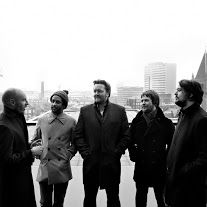 Elbow are an English alternative rock band comprising Guy Garvey, Richard Jupp, Craig Potter, Mark Potter, and Pete Turner.