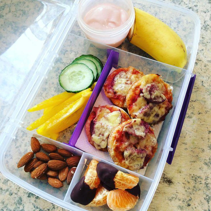 Lunch box idea : Strawberry yoghurt  Banana  Sliced cucumber  Yellow capsicum  Almonds  Mini pizzas  Dark chocolate dipped mandarin
