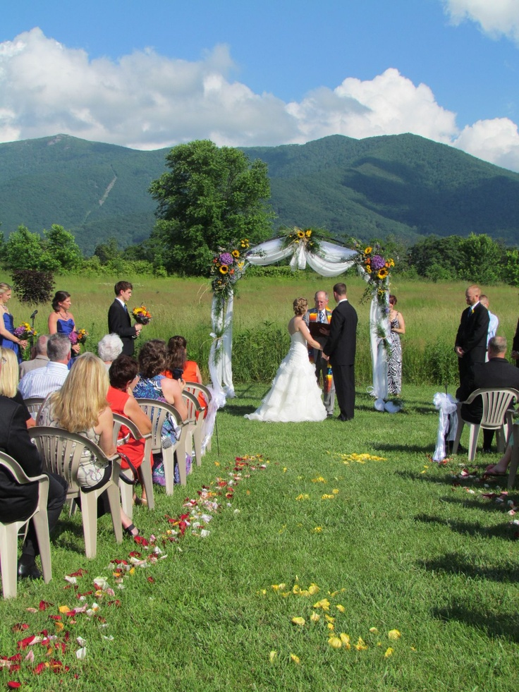 Love all the bright colors from real rose petals lining the aisle! And arbor was beautifully decorated! @ Khimaira Farm outdoor barn wedding venue Shenandoah Valley Blue Ridge Mountains Luray VA