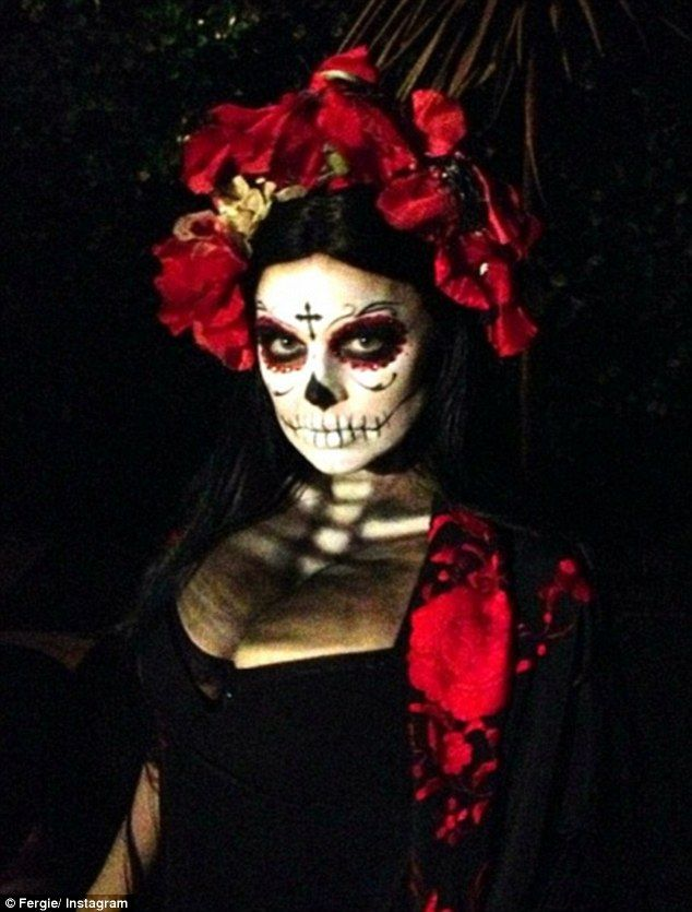 Spooktacular: Fergie just could not wait to show off her Day of the Dead inspire costume, posting a picture of her impressive makeup and gow...