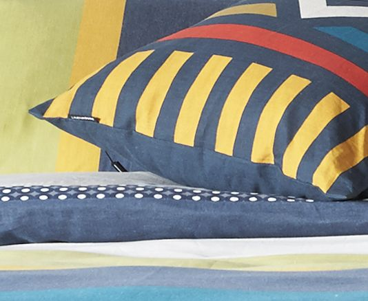 Inspired by the bold, graphic designs which decorate the houses of the African Ndebele people, this cotton yarn dyed stripe Ndebele quilt cover from Linen House has beautiful depth of colour and a strong, masculine feel. The reverse is cotton percale with a smart geometric print.