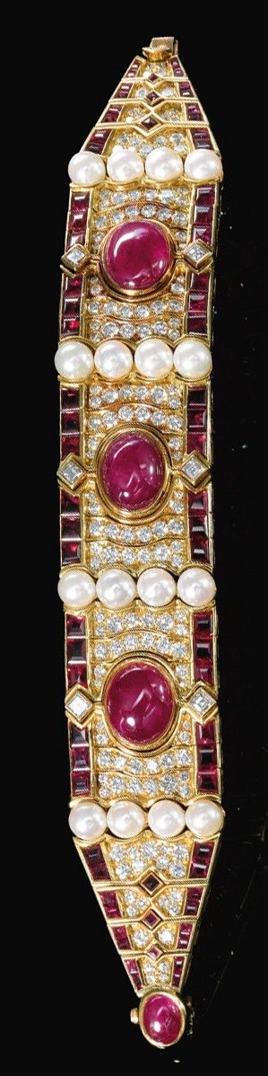 CULTURED PEARL, RUBY AND DIAMOND BRACELET, BULGARI, 1980S. The front set with three oval cabochon rubies, surrounded with undulating lines of brilliant-cut diamonds, framed at either side with calibré-cut rubies, and embellished with rows of cultured pearls, length approximately 177mm, signed Bulgari, Italian assay and maker's marks.