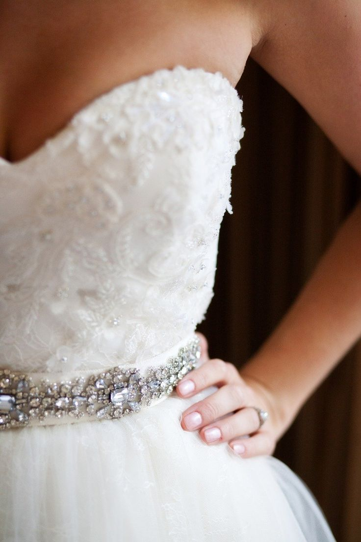 Use accessories like this belt to add to your already beautiful wedding gown Forever Amour Bridal (212) 486- 2900 www.ForeverAmourBridal.com New York, New York 10022