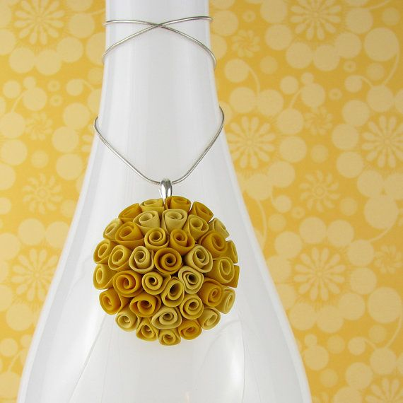 Polymer clay rose medallion necklace...Etsy listing at https://www.etsy.com/listing/234484340/clearanceyellow-roses-medallion-pendant