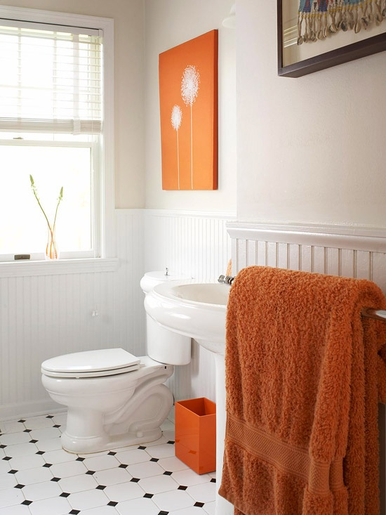 Love the idea of an all white bath where you can swap out accessories for a different look. I love how to orange pops here. So many options. Yellow, green, purple...you name it