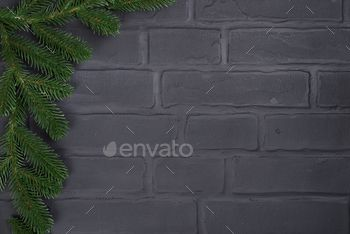 Christmas tree on brick wall background