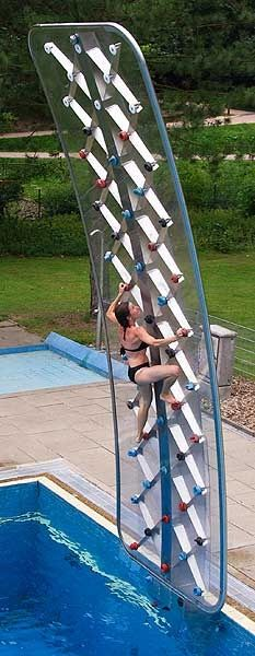 rock climbing wall over a pool! Really cool idea!