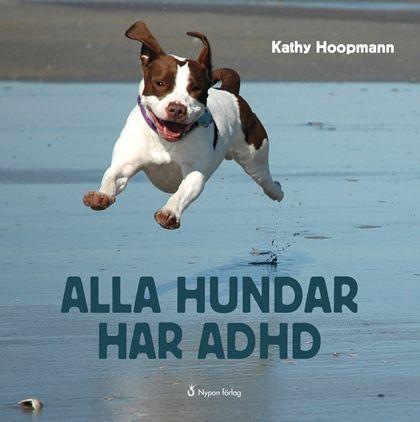 Den här ser ut som en fotobok, full av ljuvliga bilder på charmiga hundar. Och…