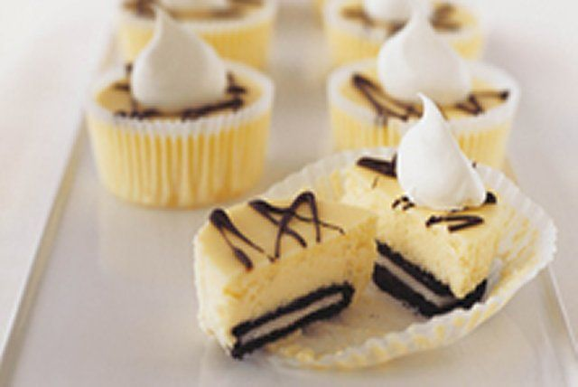 These easy mini cheesecakes, made with cream cheese, OREO Cookies and semi-sweet chocolate are baked in muffin cups for easy prep and clean-up.  This is our fuss-free version of a cheesecake classic.