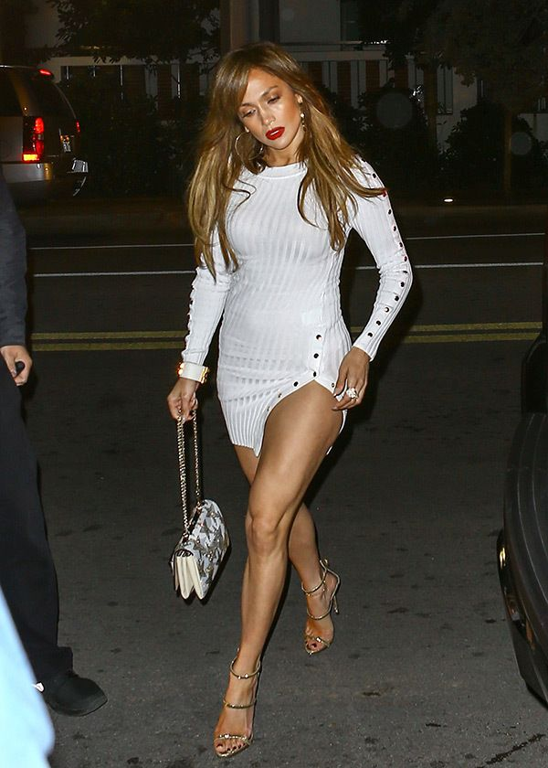 Jennifer Lopez shows off her long toned legs in this mini white dress on date night with Alex Rodriguez!