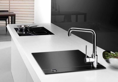 Minimalist Kitchen Sinks with Movable Cutting Board and Retractable Faucets | DigsDigs